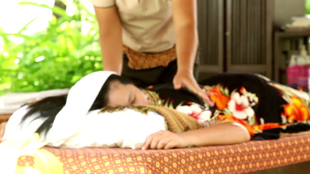 woman relaxing while getting oil back massage - massage oil videos stock videos and b-roll footage