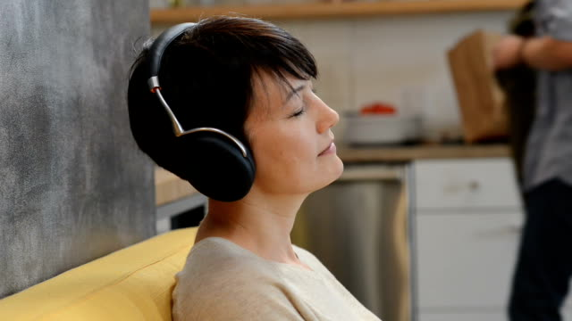woman relaxing with headphones - buddhism stock videos & royalty-free footage