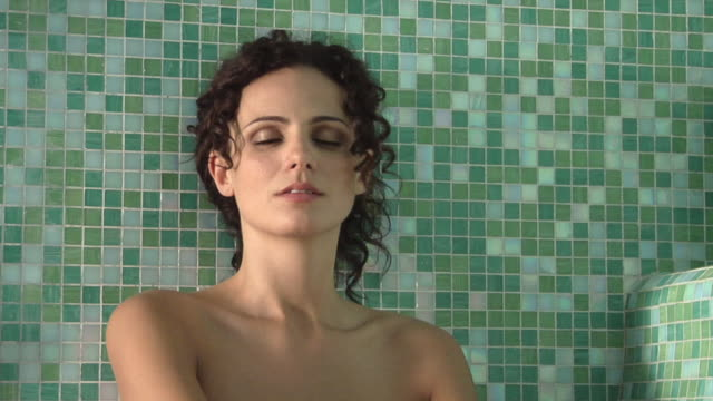 vidéos et rushes de cu woman relaxing with her eyes closed and smiling in sauna / norcia, italy  - sauna