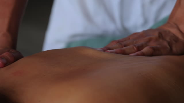 cu ts woman relaxing with massage / north island, seychelles - massager stock videos and b-roll footage