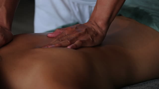 cu ts woman relaxing with massage / north island, seychelles - massieren stock-videos und b-roll-filmmaterial