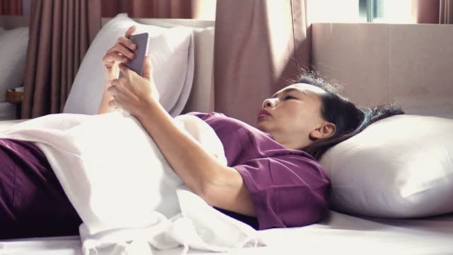 woman relaxing with Thai massage and using phone , panning shot