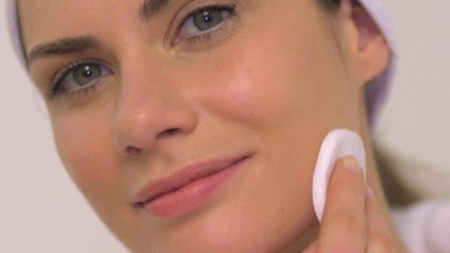 CU SLO MO Woman removing make-up / London, Greater London, United Kingdom