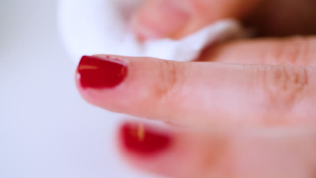 cu woman removing red nail polish - removing stock videos & royalty-free footage