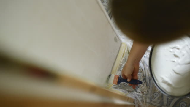 woman renovating a wall in her house. - bricolage video stock e b–roll
