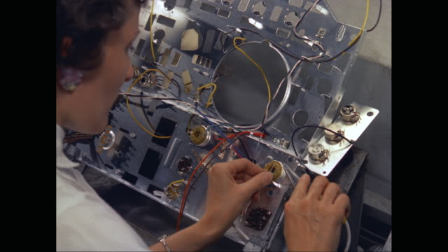 CU HA Woman repairing electronic circuit board / United States