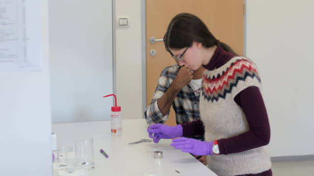 woman researcher analyzing scientific sample while student watches her - scientific sample stock videos & royalty-free footage
