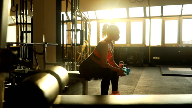 woman resting after training - strength training stock videos & royalty-free footage