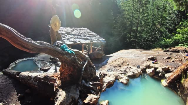 woman resting in an hot spring in oregon - umpqua national forest stock videos & royalty-free footage