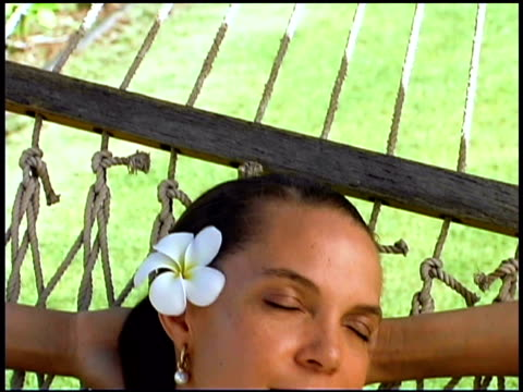 woman resting in hammock - one mid adult woman only stock videos & royalty-free footage