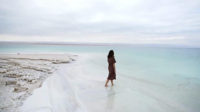 Woman resting near Dead Sea