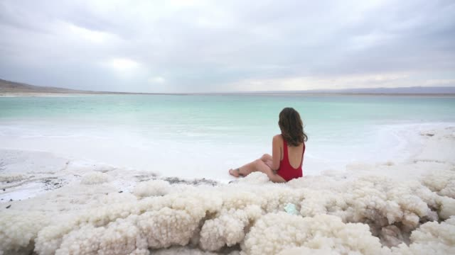 woman resting near dead sea - mineral stock videos & royalty-free footage