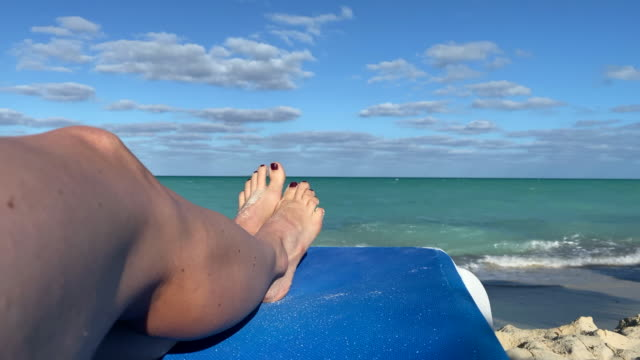 woman resting on tropical beach in the caribbean - toe stock videos & royalty-free footage