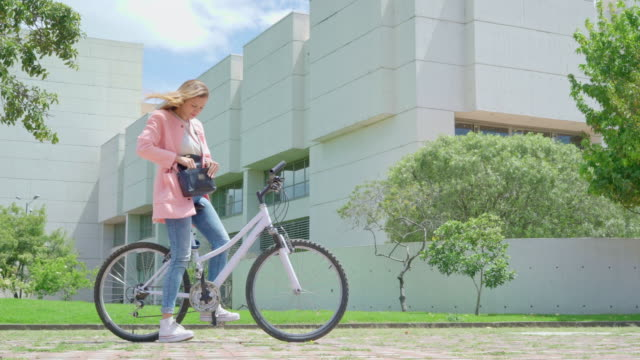 woman rides a bicycle - colombian ethnicity stock videos & royalty-free footage