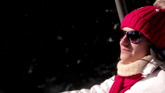 Woman rides on ski lift,close up
