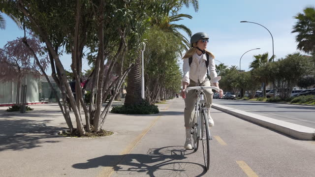 woman riding a bicycle commuting to work - bicycle stock videos & royalty-free footage