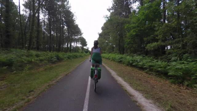 woman riding a bike, back view