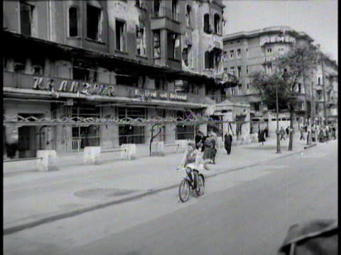 woman riding bicycle following behind camera / berlin, germany - 1945 stock-videos und b-roll-filmmaterial