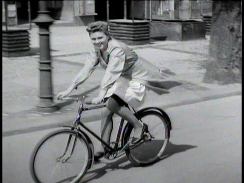 woman riding bicycle following camera / berlin, germany - 1945 stock videos & royalty-free footage