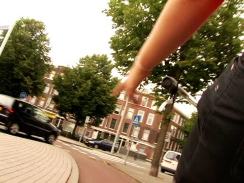 pov, woman riding bike on bike lane, rotterdam, netherlands - roundabout stock videos & royalty-free footage