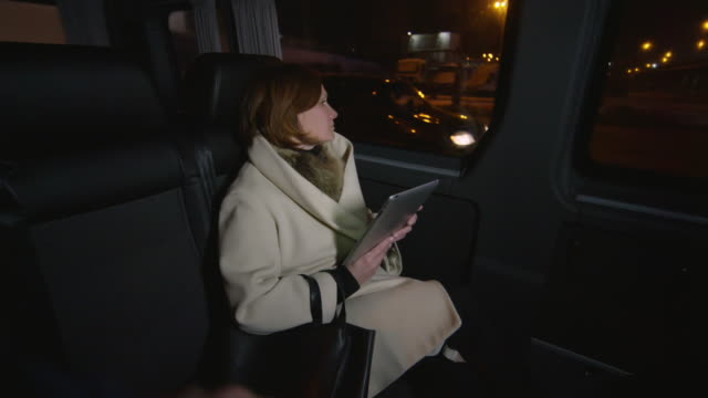 woman riding bus home and looking out of window in contemplation - brown hair stock videos & royalty-free footage