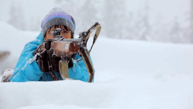 cu pan woman rifle shooting in snowy winter day / whistler ,bc ,canada - biathlon stock videos and b-roll footage