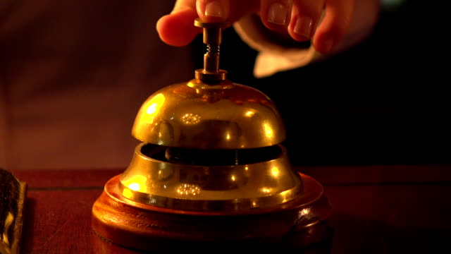 woman ringing hotel reception bell - bell stock videos and b-roll footage