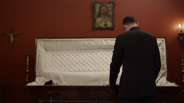 a woman rises from the dead in a funeral home - coffin stock videos & royalty-free footage