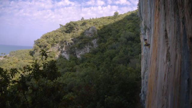 woman rock climber - rock face stock videos & royalty-free footage