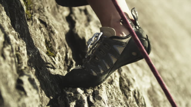 cu woman rock climbing on cliff, view of foot, squamish, british columbia, canada - human foot stock videos & royalty-free footage