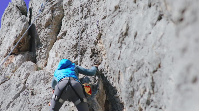 woman rock climbing - cliff stock videos & royalty-free footage