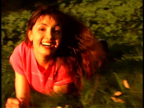 vidéos et rushes de woman rolling in field - rouler ou dérouler