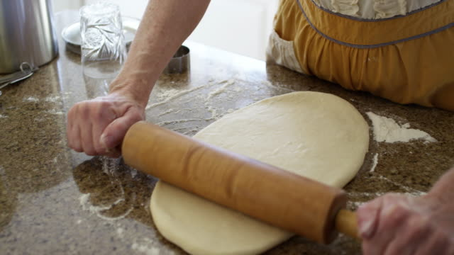 Woman Rolling out the Dough