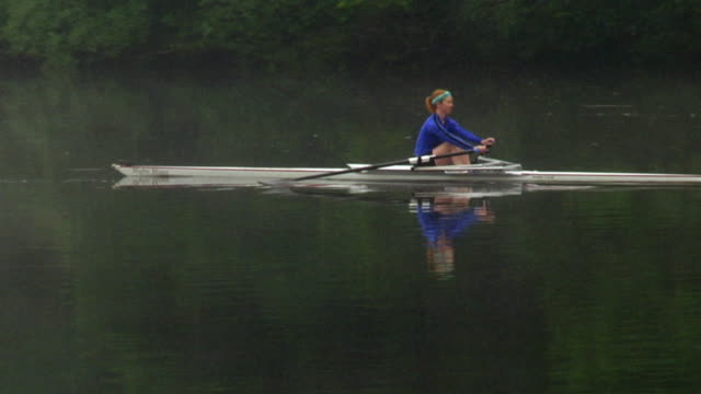 ws pan woman rowing in single scull on the connecticut river at dawn/ hanover, new hampshire, usa - man made stock videos & royalty-free footage