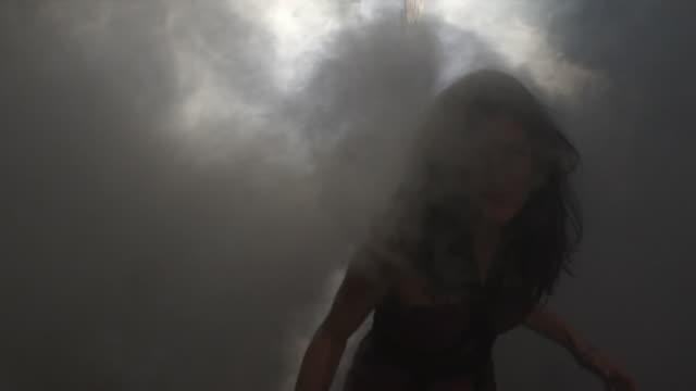 SLO MO MS Woman rubbing eyes to see through smoke, men in HAZMAT suits behind, Atlanta, Georgia, USA