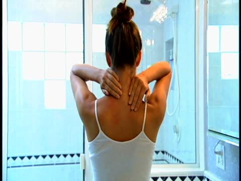 woman rubbing neck - neckache stock videos & royalty-free footage