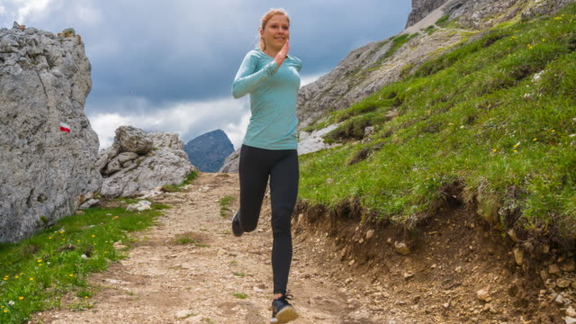 woman runner running off road on mountain paths - tyrol state austria stock videos and b-roll footage