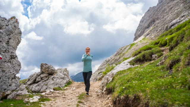 woman runner running off road on mountain paths - off the beaten path stock videos & royalty-free footage