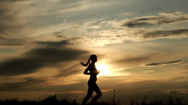 woman running against sunset - lockdown viewpoint stock videos & royalty-free footage