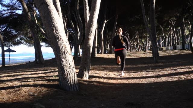 Woman running at beach.
