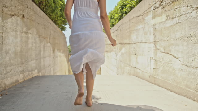 slo mo woman running barefoot to the beach - sundress stock videos & royalty-free footage