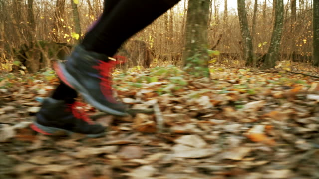 woman running close up in slow motion. - obscured face stock videos & royalty-free footage