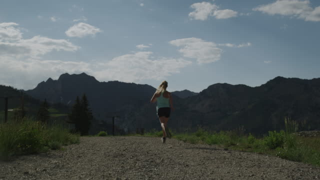 woman running down a trail - brighton ski area stock videos and b-roll footage