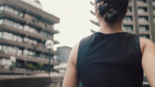 woman running in city - city life stock videos & royalty-free footage