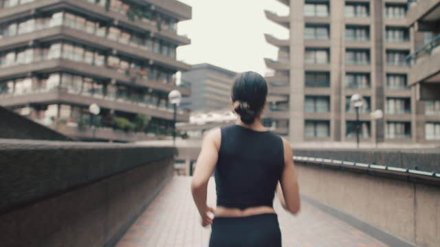 woman running in city - active lifestyle stock videos & royalty-free footage
