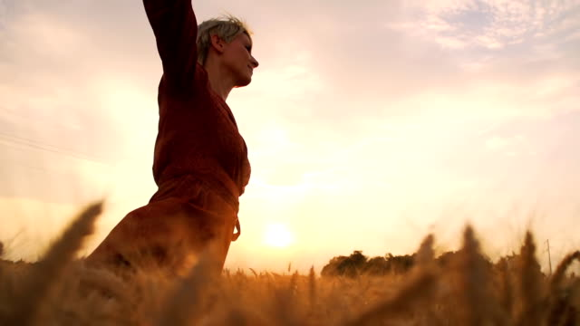 HD SUPER SLOW-MOTION: Woman Running In Field At Sunset