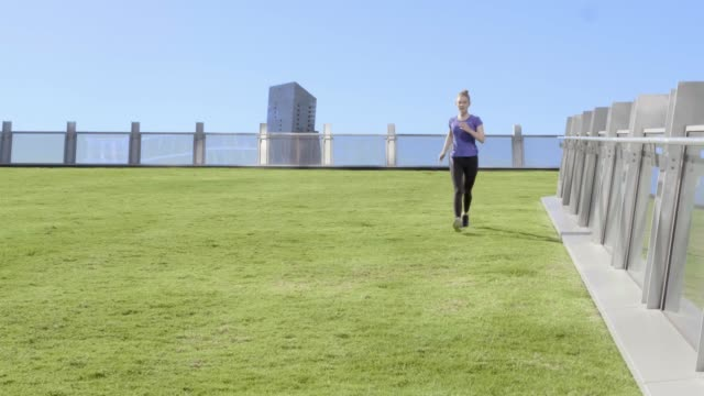 woman running in rooftop garden