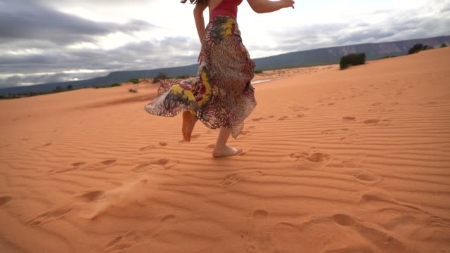 woman running in sand dunes - arid stock videos & royalty-free footage