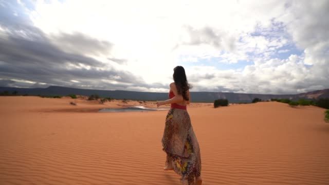 woman running in sand dunes - desert oasis stock videos & royalty-free footage