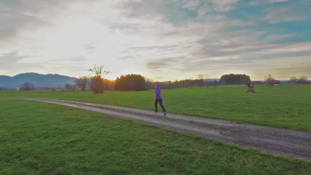 Woman running in sunset